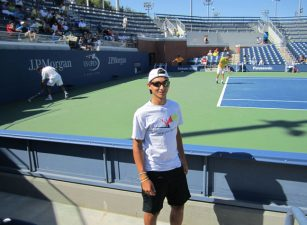 boy-standing-front-tennis-match