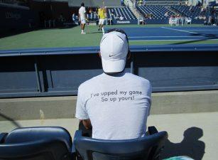 man-watching-tennis-match